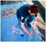 Jo Letchford working on the restoration of a large mosaic on the seafront in Dover, Kent